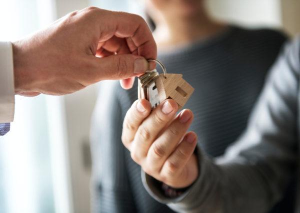 handing homeowners keys